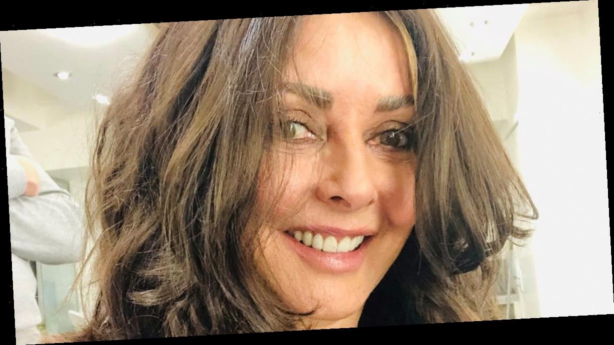 Carol Vorderman is unrecognisable as she debuts sultry brunette curls