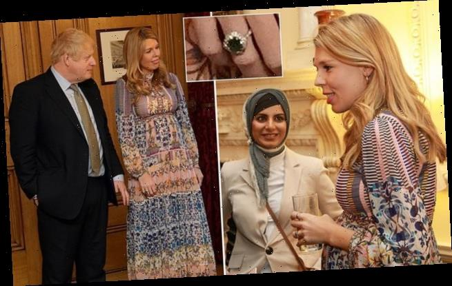 Carrie Symonds shows off her bump and engagement ring