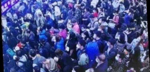 Huge queues of people wait to enter China amid coronavirus pandemic