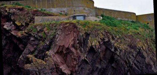 Dad buys remote island in Wales and renovates wartime fort into family home