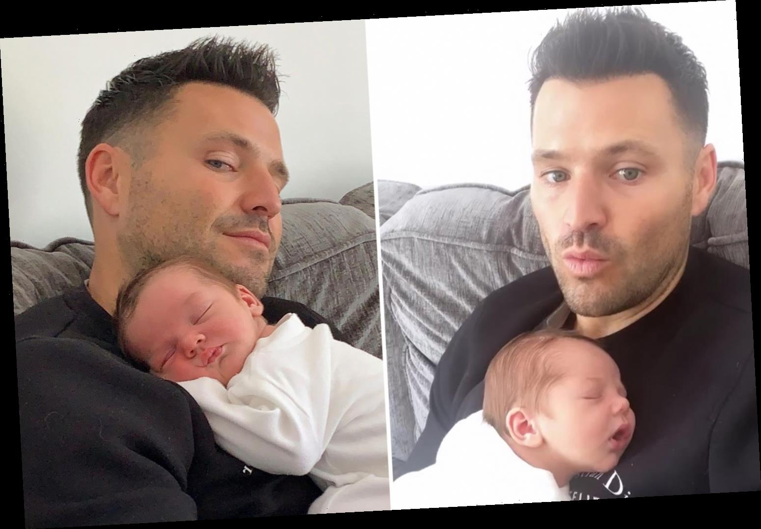 Mark Wright looks broody as he cuddles up to Michelle Keegan's cousin's newborn baby