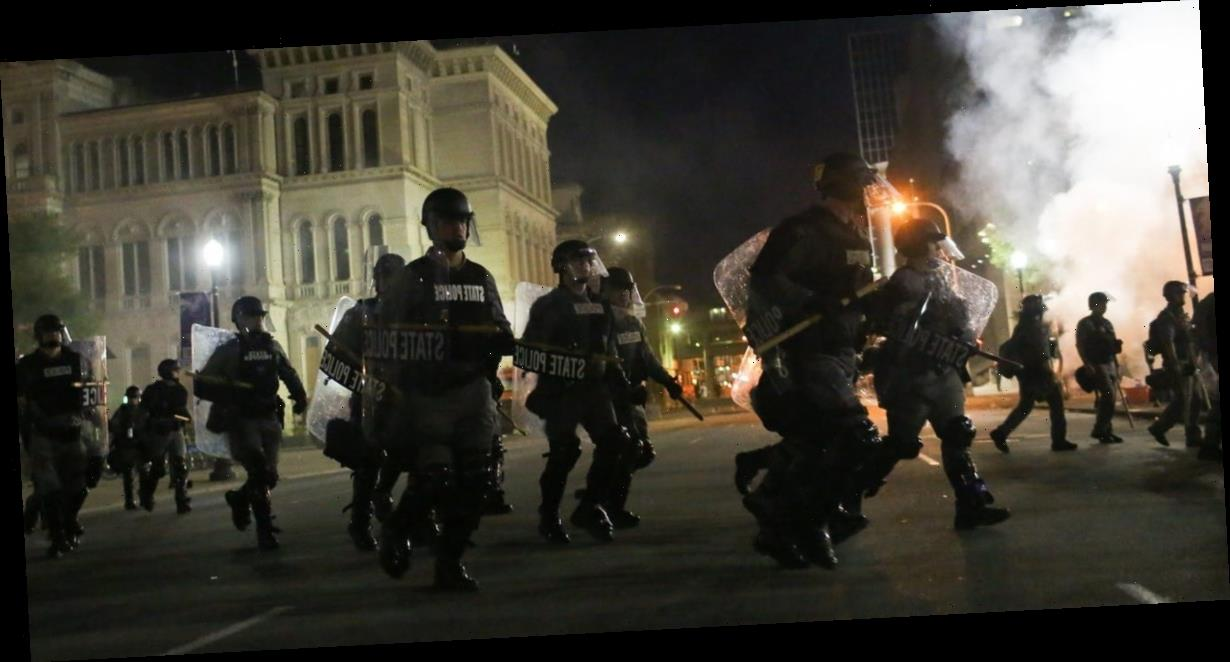 Photos show angry protests in Louisville after no police were indicted for killing Breonna Taylor