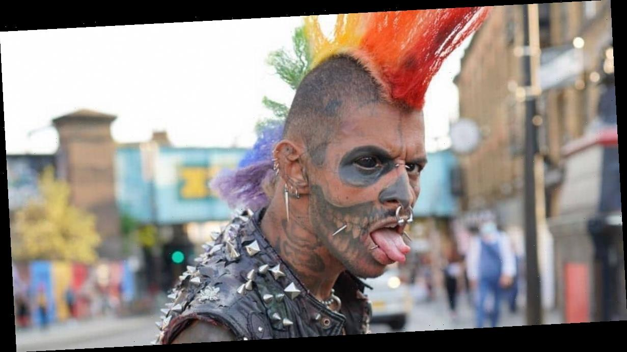 Body mod fan turns himself into 'Zombie' with inked eye and split tongue