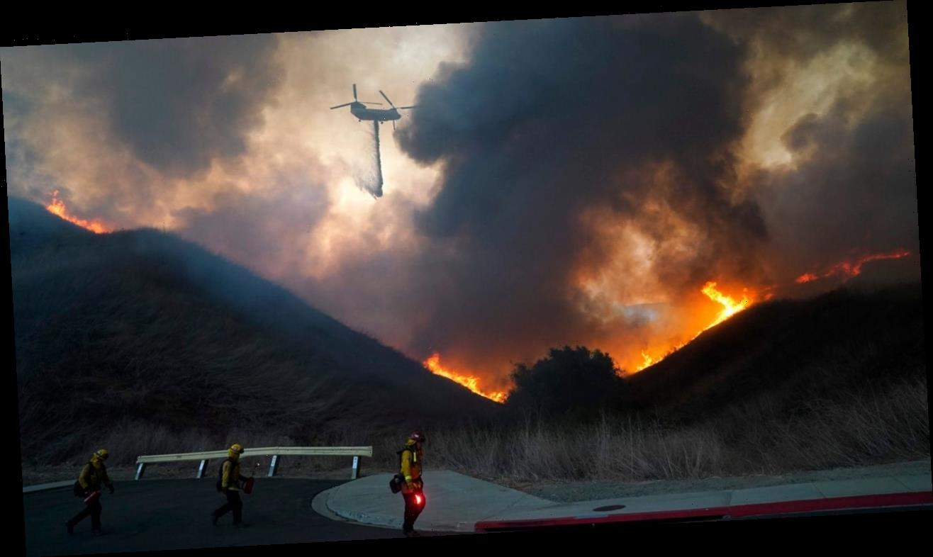 California wildfires explode in size, 2 injured firefighters 'fighting for their lives'