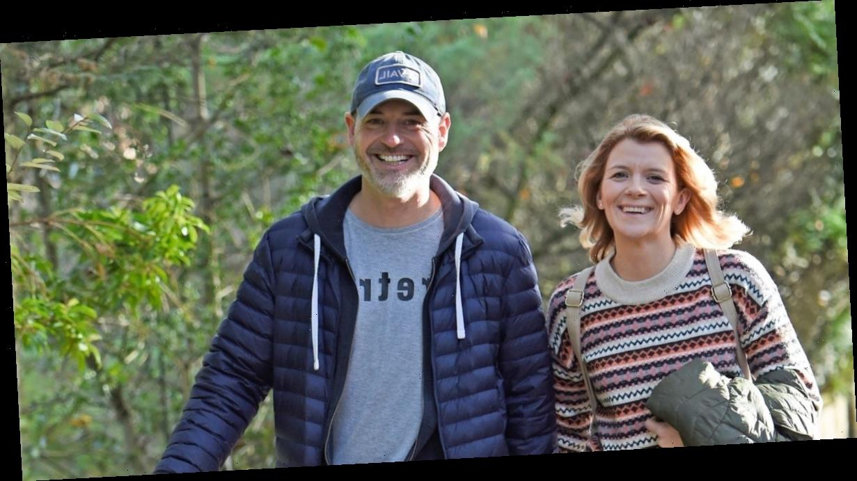 Coronation Street's Jane Danson and husband Robert Beck are all smiles as they hold hands on dog walk