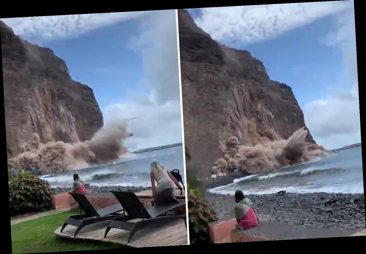 Shocking moment a giant chunk of cliff collapses and crashes onto a Canary Islands beach yards away from holidaymakers