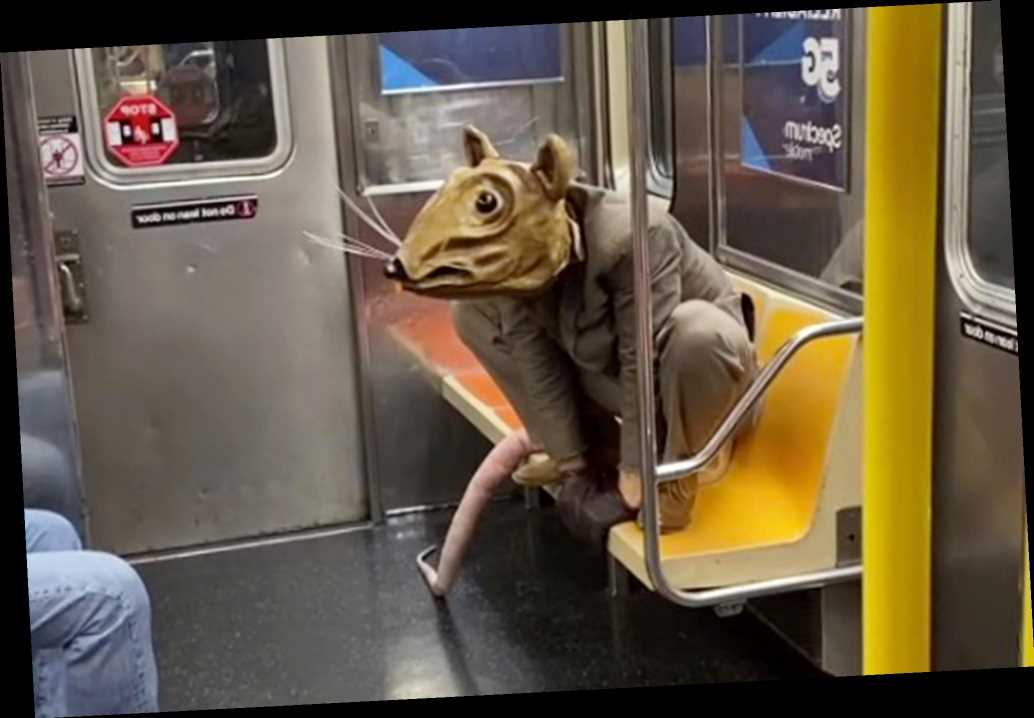 Man dressed as giant rat takes subway mask requirement to new heights