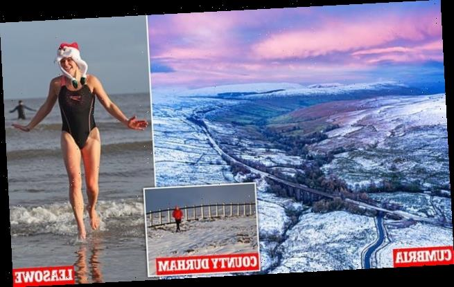 Brave swimmers take dip in cold water and walkers enjoy stroll in snow