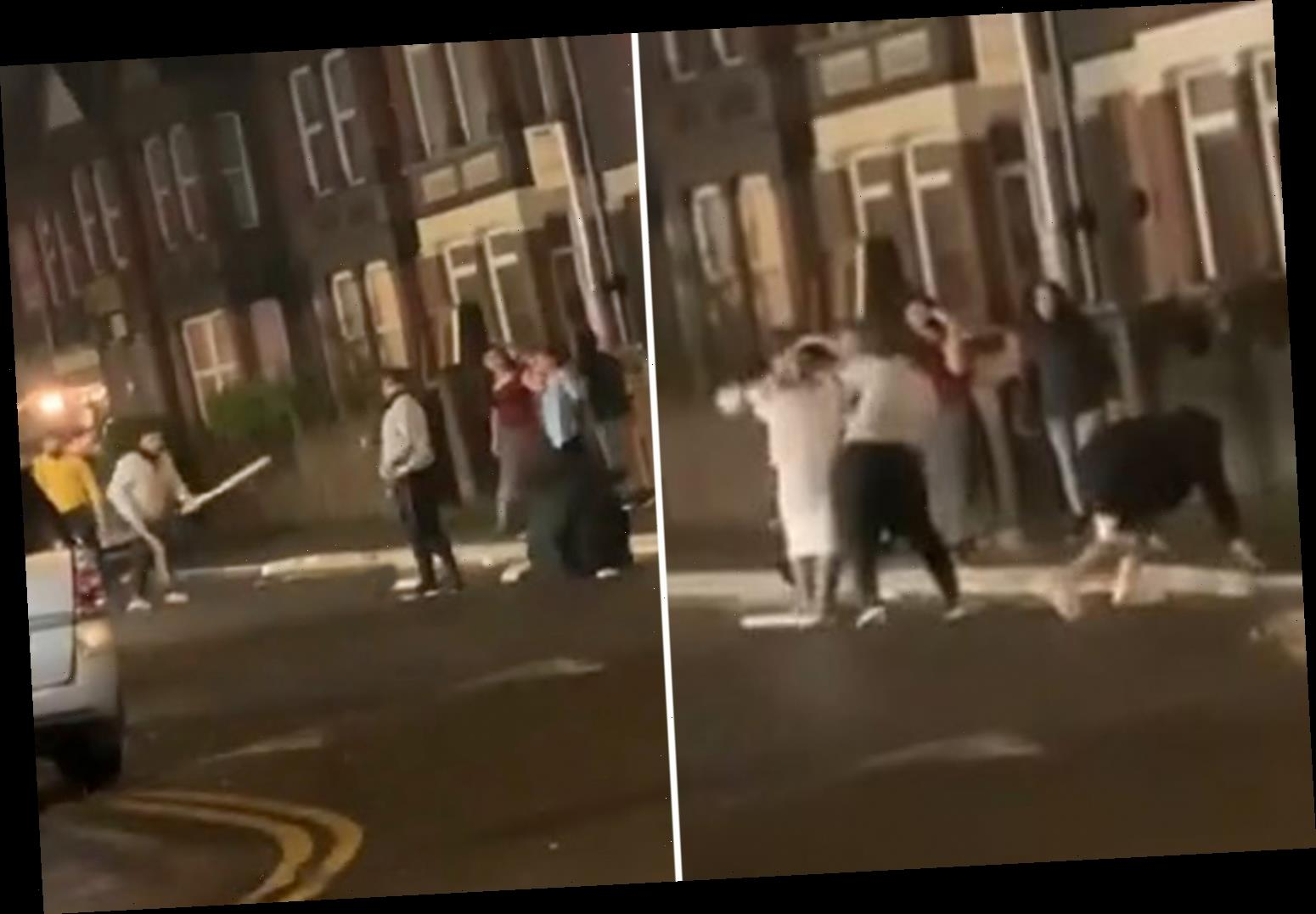 Moment street fighters batter each other with cricket bats and crates in wild west-style brawl