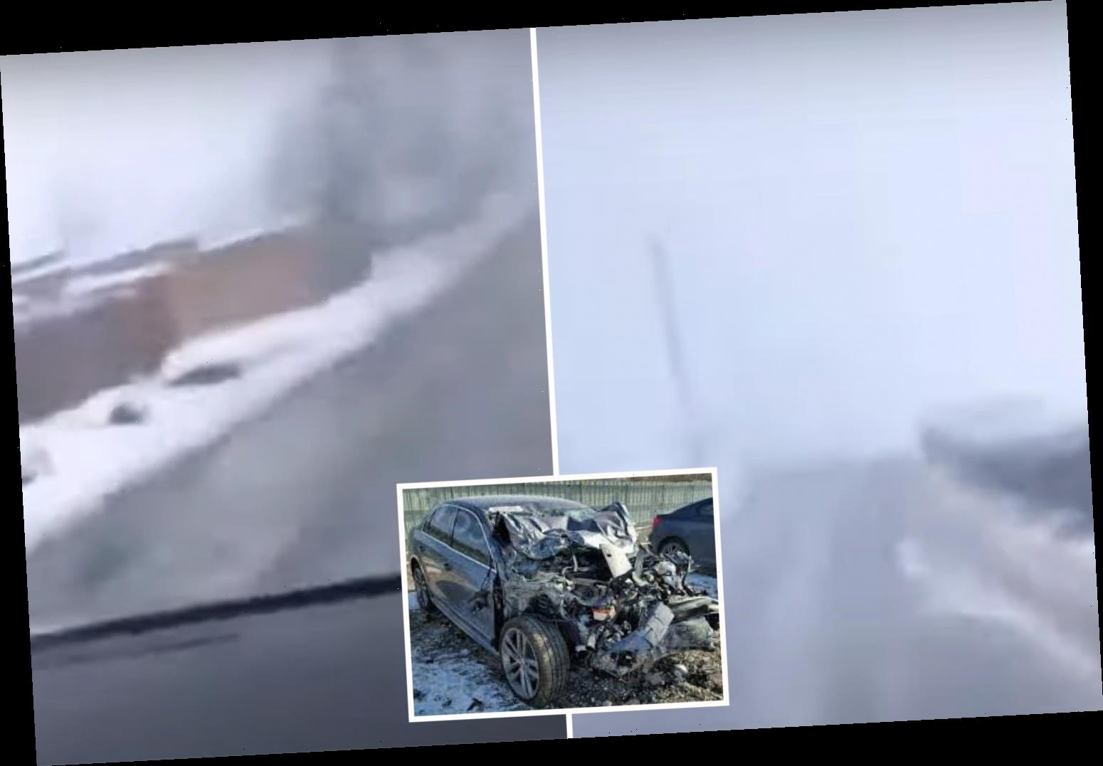 Scary moment VW racing down icy lane spins out of control and crashes in heavy snow