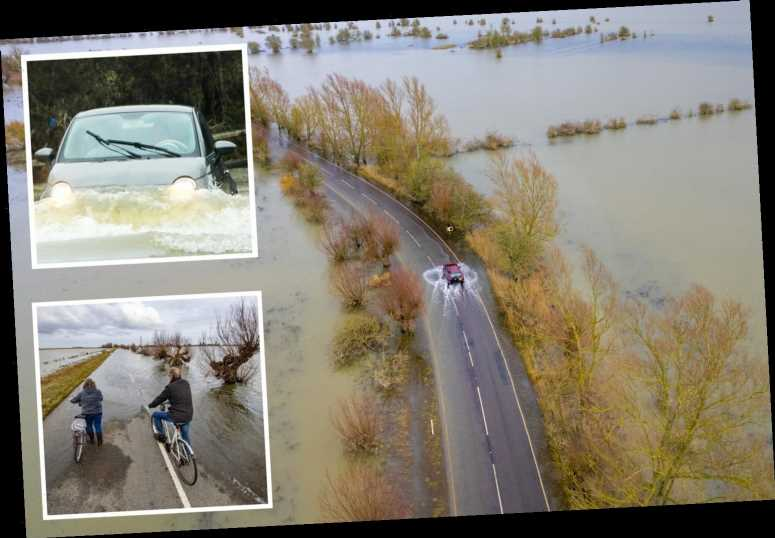 Flood warnings for FOUR DAYS as torrential rain lashes Britain – but temperatures rocket to 15C