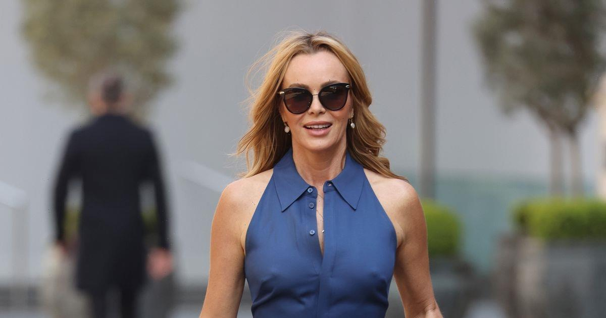 Amanda Holden goes braless and flaunts curves in chic blue jumpsuit as she soaks up sunshine