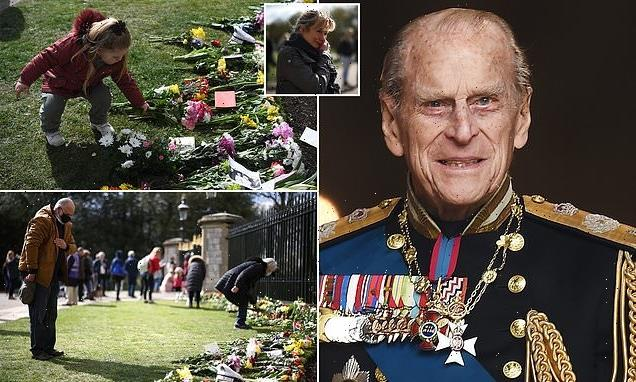 Mourners shed tears for Prince Philip as they place MORE flowers
