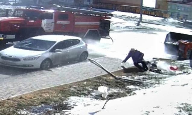 Pedestrian is knocked off her feet by a powerful fire hose