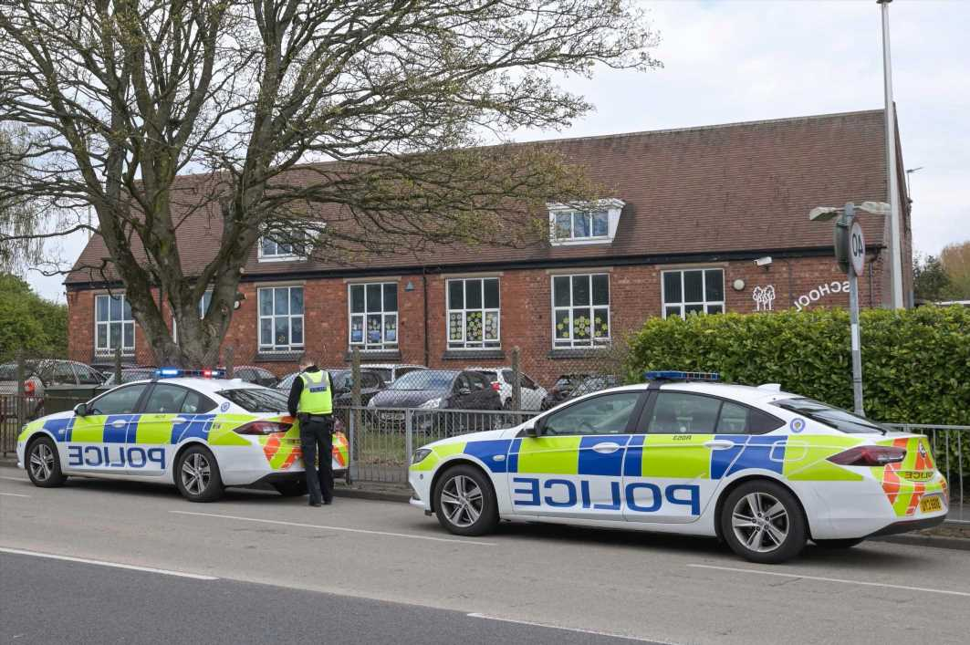 Primary school on lockdown with parents told 'stay home' as police with sniffer dogs swoop