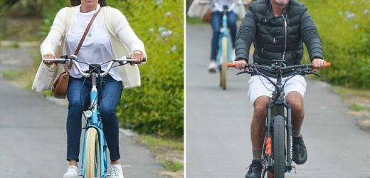 Brave Simon Cowell is back on his bike on ride with girlfriend Lauren after horror accident that almost paralysed him