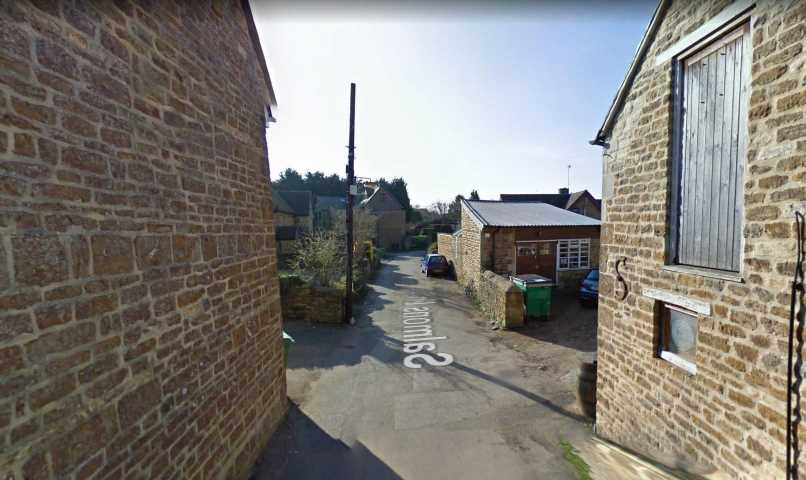 Body of man found after shed fire as woman, 64, arrested on suspicion of murder in posh village