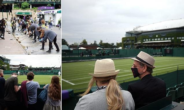 Crowds head to second day of Wimbledon with MORE downpours predicted