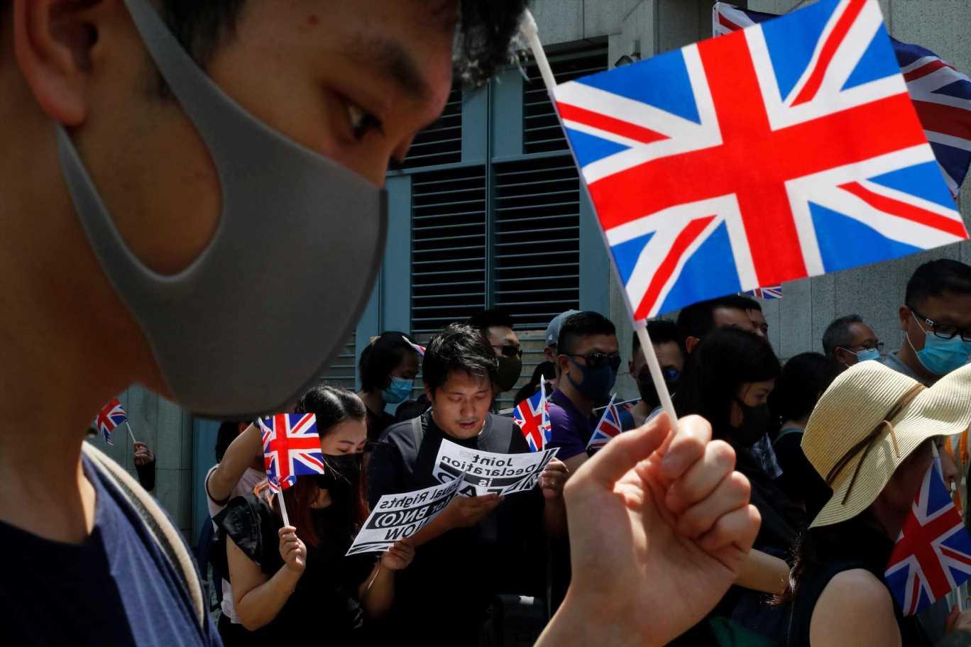 Hong Kong to ban passenger flights from UK to curb virus