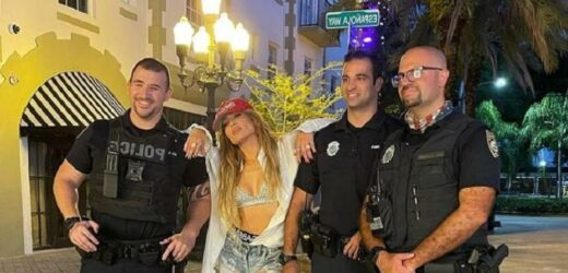 Jennifer Lopez poses for photo with Miami Beach police officers during video shoot