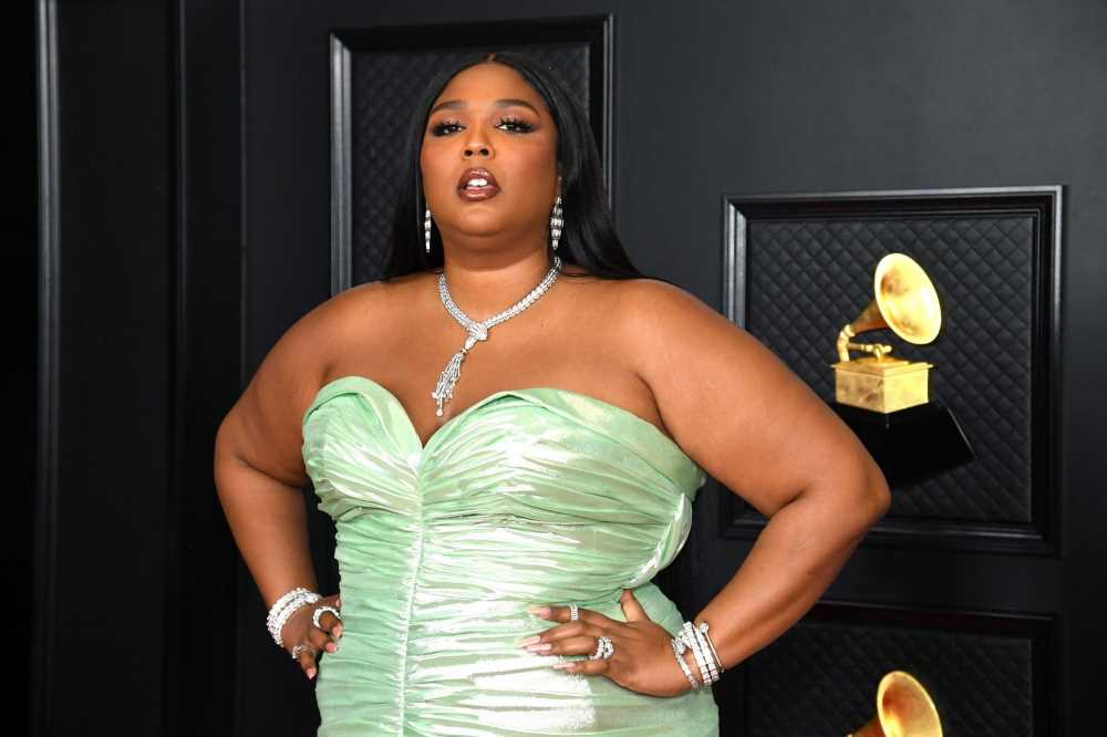 Lizzo pastes her face on the Mona Lisa in must-see fashion statement