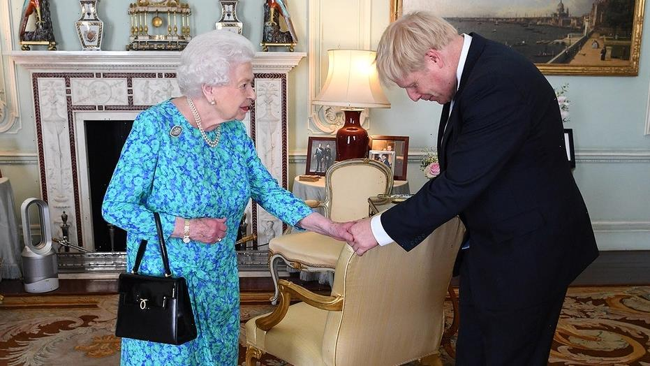 Queen Elizabeth meets Boris Johnson at Buckingham Palace for their first in-person audience since the pandemic