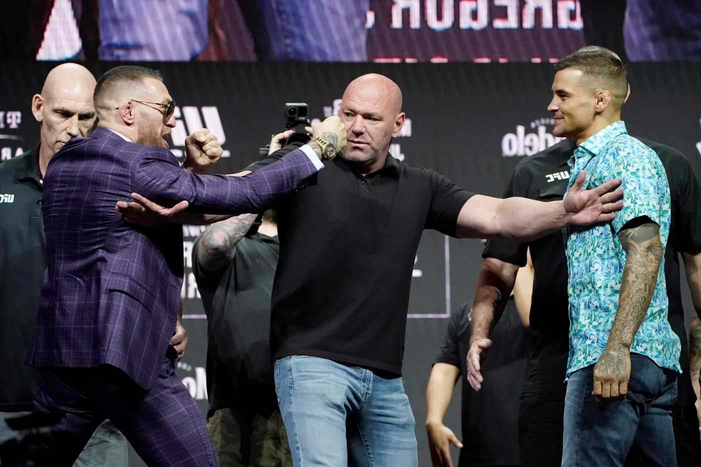 Conor McGregor back to bad boy ways after trying to KICK Dustin Poirier and threatening to take head off at UFC presser