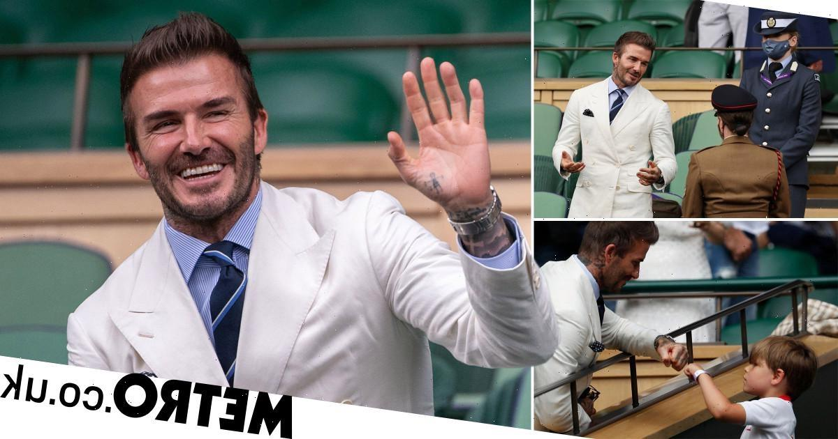 David Beckham is suited and booted as he hits up Wimbledon