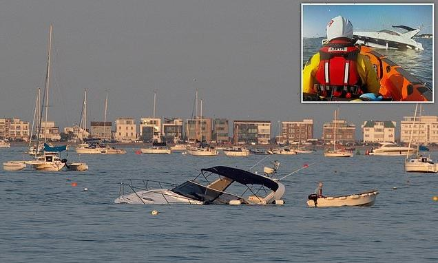 Dramatic moment a £150,000 42ft yacht SINKS in the sea off Sandbanks