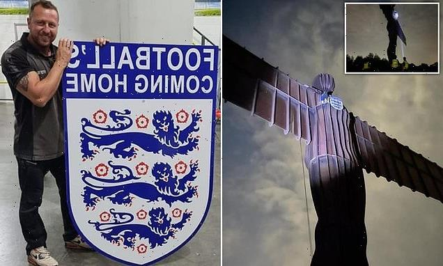 Giant England football badge is pinned on Angel of the North