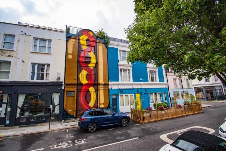 Posh neighbours stunned as massive HOT DOG painted on house on leafy London street