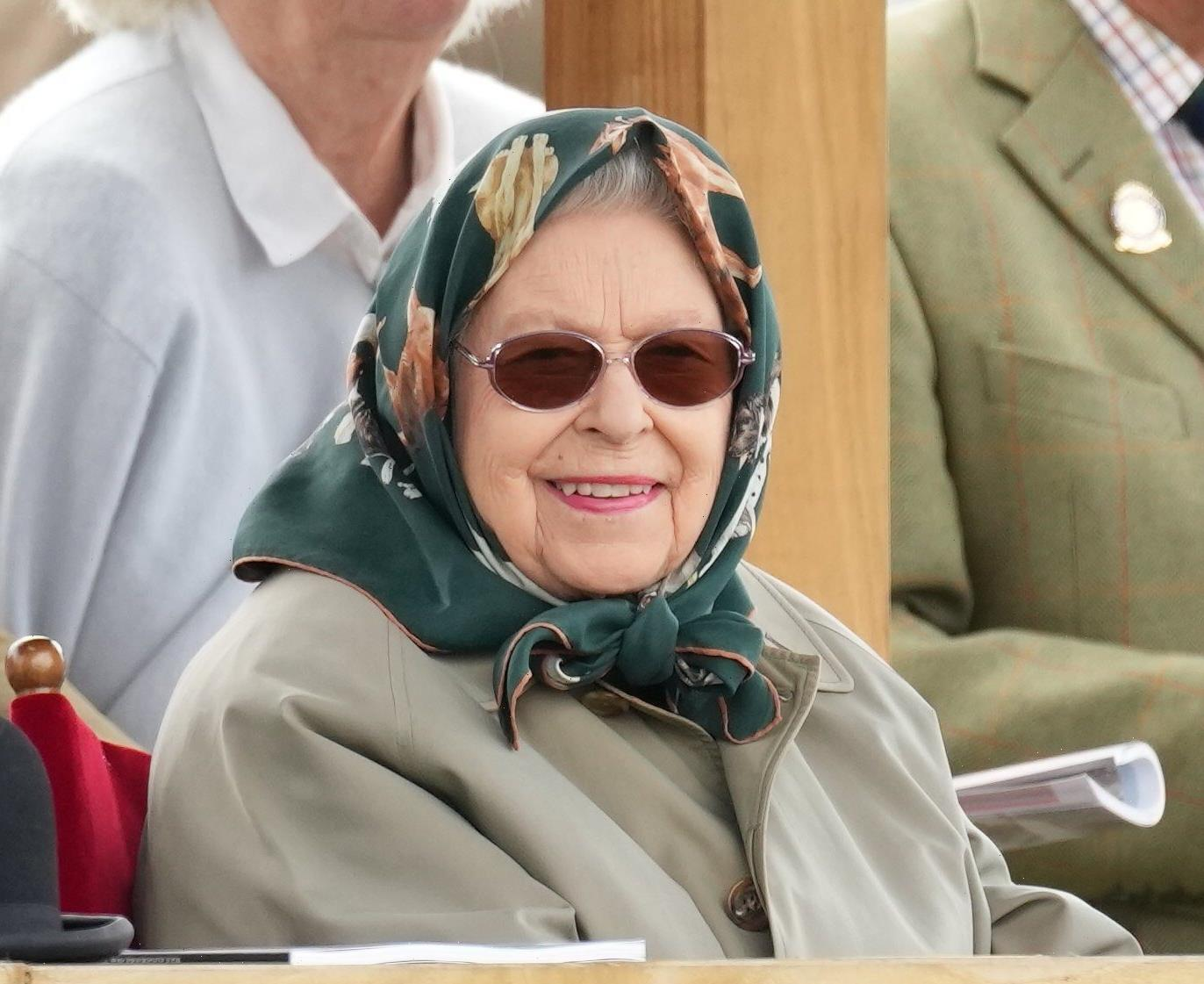 Queen all smiles again as she arrives at Royal Windsor Horse Show wrapped in headscarf and jacket