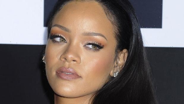 Rihanna Stuns In New Black & White Fenty Parfum Photos With Ear Dripping In Diamond Earrings