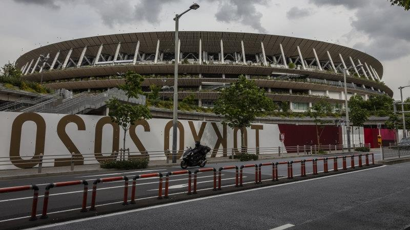 Tokyo to put further restrictions on Olympic spectators as COVID cases climb