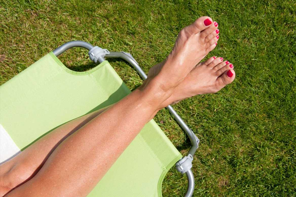 Woman's neighbour threatens to report her for anti-social behaviour for sunbathing in her bikini in a communal garden