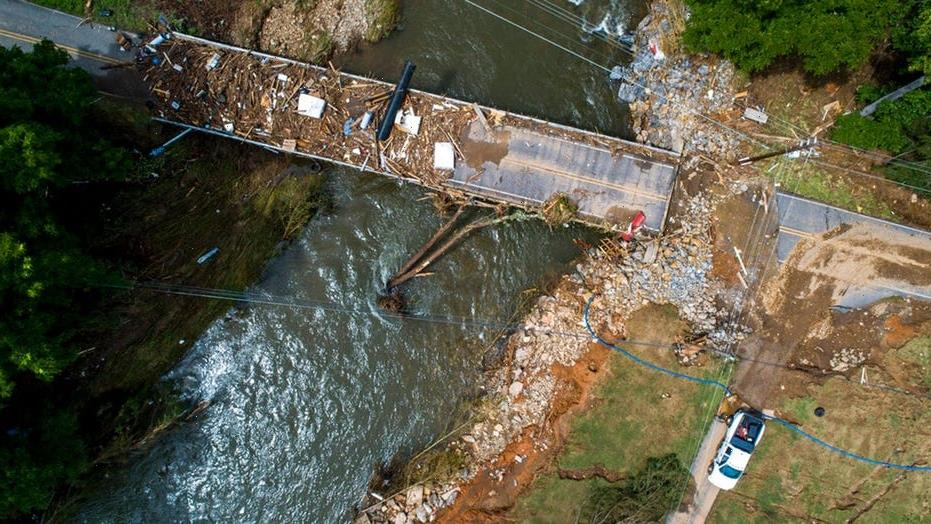 Search for 17 missing in North Carolina floods continues