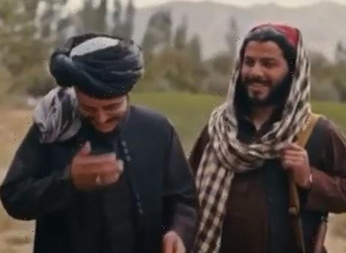 Chilling moment Taliban militants LAUGH & tell crew to 'stop filming' as female interviewer asks about women's rights