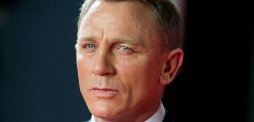 Daniel Craig bemused after trunks sold for eye-watering sum as Dench banged the gavel