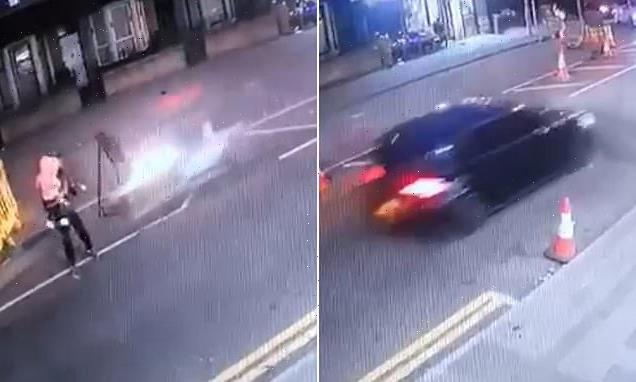 Shocking moment father carrying daughter, two, is mown down by bike