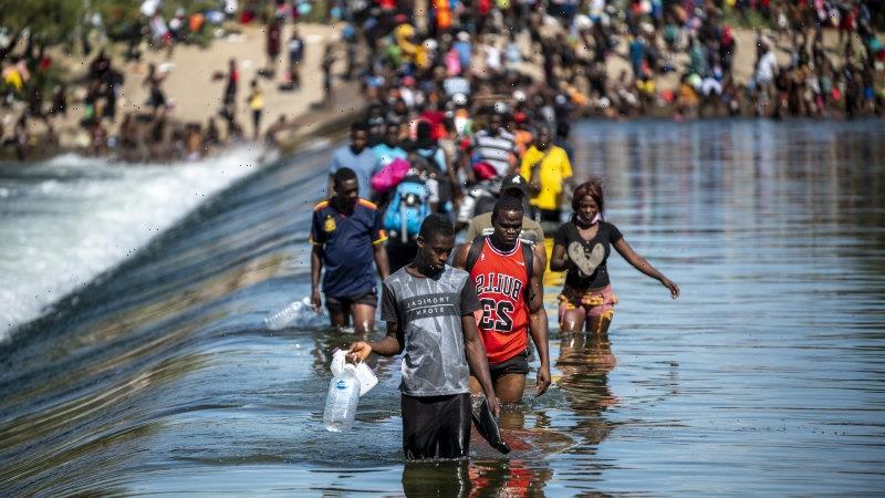 Thousands of Haitians mass under bridge in Texas in new migrant emergency