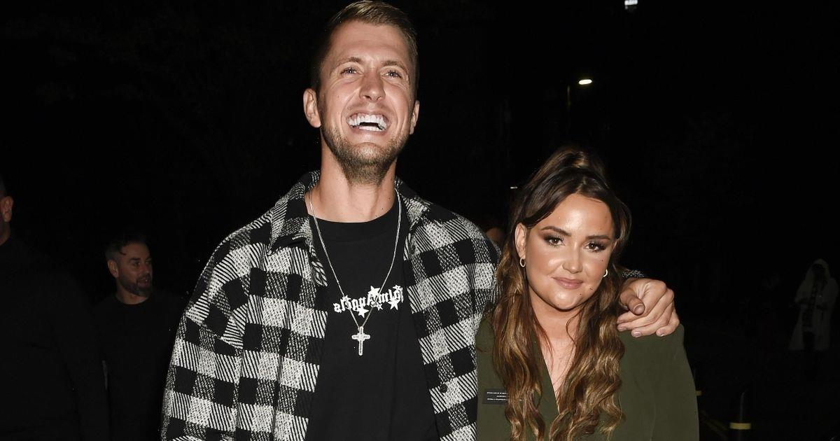 Dan Osborne beams as he puts arm around wife Jacqueline Jossa after his boxing match