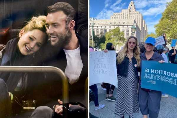 Jennifer Lawrence shows off baby bump in dress at women's march as she expects first child with husband Cooke Maroney