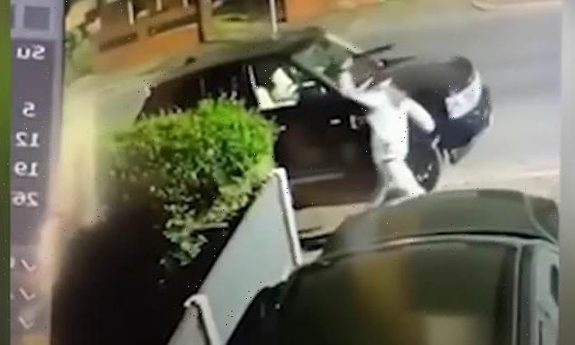 Moment machete-wielding man smashes several cars in Manchester
