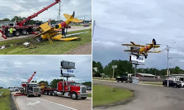 Pilot survives as plane hits traffic lights and smashes into highway