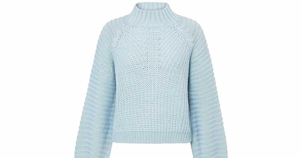We're Cozying Up in This Adorable Cropped Sweater Once Temps Drop